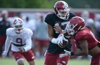 Arkansas quarterback Nick Starkel (17) hands the ball off Tuesday, Aug. 20, 2019, to running back Rakeem Boyd during practice at the university's practice facility in Fayetteville. Visit nwadg.com/photos to see more photographs from the practice.