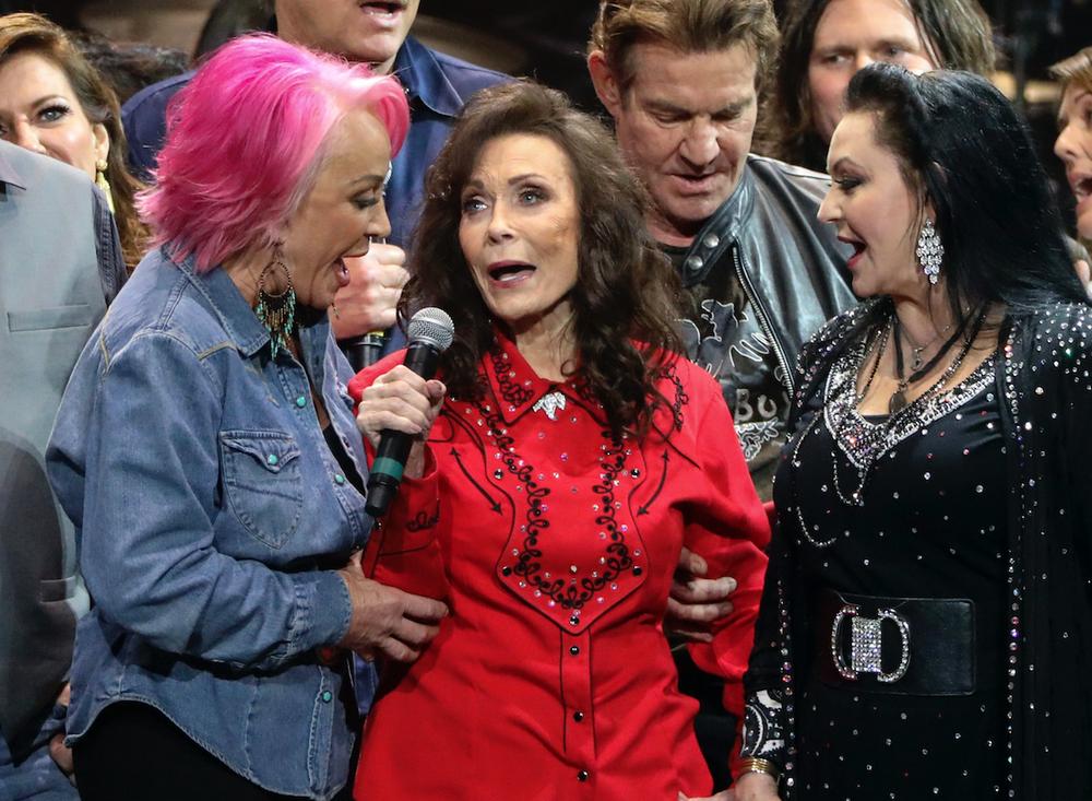 Tanya Tucker (left), Loretta Lynn (center) and Crystal Gayle perform at Loretta Lynn's 87th Birthday Tribute on April 1 in Nashville. (AP)