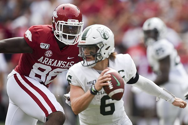 Arkansas defensive end Jamario Bell (86) chases Portland State quarterback Davis Alexander during a game Saturday, Aug. 31, 2019, in Fayetteville.
