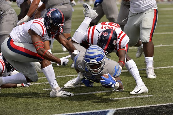 Memphis running back Kenneth Gainwell dives for the end zone as he is brought down by Ole Miss defensive back A.J. Finley in the first half of an NCAA college football game Saturday, Aug. 31, 2019, in Memphis, Tenn. (AP Photo/Brandon Dill)