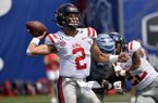 Ole Miss quarterback Matt Corral (2) throws a pass in the first half of an NCAA college football game against Memphis, Saturday, Aug. 31, 2019, in Memphis, Tenn. (AP Photo/Brandon Dill)