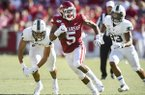 Arkansas running back Rakeem Boyd (5) runs during a game against Portland State on Saturday, Aug. 31, 2019, in Fayetteville.