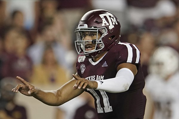 Texas A&M's Kellen Mond (11) directs his team against Texas State during the second half of an NCAA college football game in College Station, Texas, Thursday, Aug. 29, 2019. (AP Photo/Chuck Burton