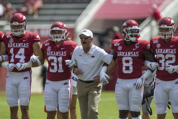 Chad Morris, Arkansas head coach, leads warmups before the game vs Portland State Saturday, Aug. 31, 2019, at Reynolds Razorback Stadium in Fayetteville.