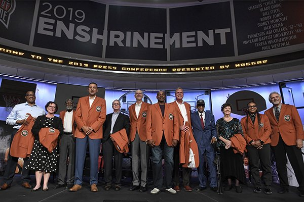Class of 2019 inductees into the Basketball Hall of Fame, from left to right, Chuck Cooper III, accepting on behalf of his late father Chuck Cooper, Susan Braun, accepting on behalf of her late father Carl Braun, Al Attles,Vlade Divac, Ron Coville accepting on behalf of his father-in-law, Bill Fitch, Bobby Jones, Sidney Moncrief, Jack Sikma, Dick Barnett for Tennessee A&I, Linda Price for Wayland Baptist, Teresa Weatherspoon, and Paul Westphal, pose for a photo during a news conference at the Naismith Memorial Basketball Hall of Fame, Thursday, Sept. 5, 2019, in Springfield, Mass. (AP Photo/Jessica Hill)