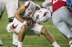 Arkansas quarterback Ben Hicks is sacked during a game against Ole Miss on Saturday, Sept. 7, 2019, in Oxford, Miss.