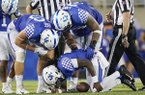 Kentucky quarterback Terry Wilson (3) is attended to by teammates after being injured on a play during the second half of an NCAA college football game between Kentucky and Eastern Michigan, Saturday, Sept. 7, 2019, in Lexington, Ky. (AP Photo/Bryan Woolston)