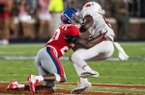Keidron Smith, Ole Miss cornerback, tackles Mike Woods, Arkansas wide receiver, for a loss in the third quarter Saturday, Sept. 7, 2019, at Vaught-Hemingway Stadium in Oxford, Miss.