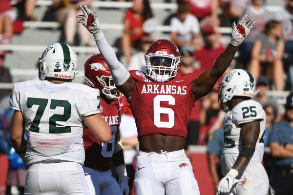 Arkansas defender Gabe Richardson celebrates after making a play against Portland State during an NCAA college football game, Saturday, Aug. 31, 2019 in Fayetteville, Ark. (AP Photo/Michael Woods)