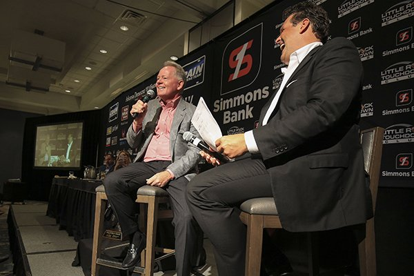 Former Arkansas football coach Bobby Petrino (left) and Little Rock Touchdown Club founder David Bazzel laugh during Petrino's speech to the club on Monday, Sept. 9, 2019, in Little Rock.