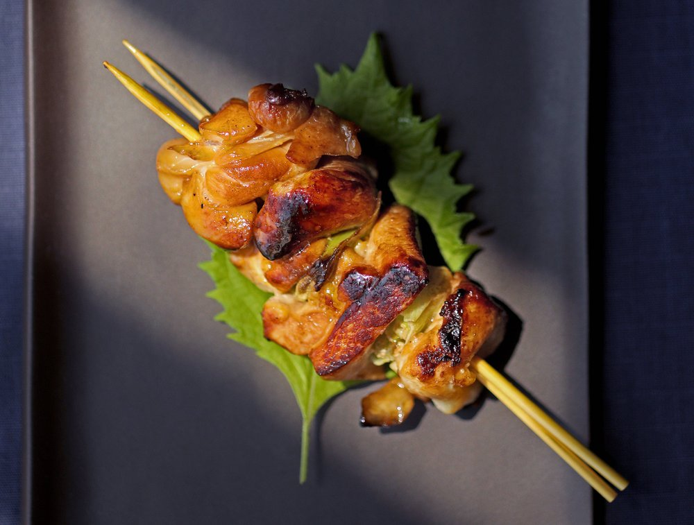 Yakitori (or chicken on a skewer) tare style. Tare is skewered with green onions and is basted with a sauce. (Christian Gooden/St. Louis Post-Dispatch/TNS)