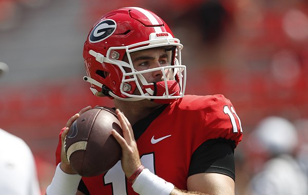 Georgia quarterback Jake Fromm (11) warms up before taking on Murray State in an NCAA college football game Saturday, Sept. 7, 2019, in Athens, Ga. (AP Photo/John Bazemore)