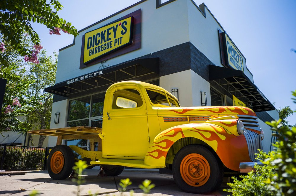 A 1941 Chevy pickup, with the bed replaced by a table and some adorning flames on the front fenders, awaits customers of Dickey's Barbecue Pit, now open -- after several delays -- in the former Starbucks at 9401 N. Rodney Parham Road, Little Rock. Arkansas Democrat-Gazette/Jeff Gammons