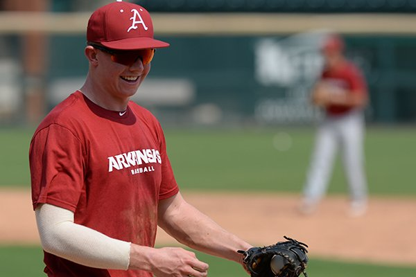 Arkansas' Heston Kjerstad warms up Friday, Sept. 6, 2019, during practice at Baum-Walker Stadium in Fayetteville.
