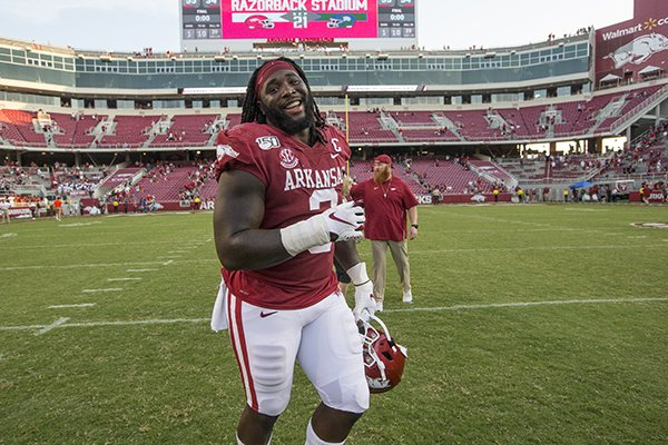 Arkansas defensive lineman McTelvin Agim runs off the field following the Razorbacks' 55-34 victory over Colorado State on Saturday, Sept. 14, 2019, in Fayetteville.