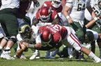 Colorado State quarterback Collin Hill is sacked by Arkansas linebacker Grant Morgan (31) during a game Saturday, Sept. 14, 2019, in Fayetteville.