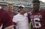 Arkansas coach Chad Morris (center) celebrates with receiver Treylon Burks (right) following the Razorbacks' 55-34 victory over Colorado State on Saturday, Sept. 14, 2019, in Fayetteville.
