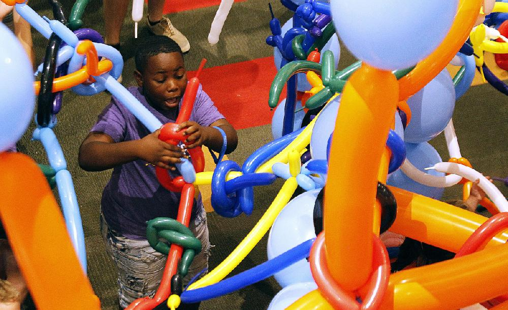 Busting, fixing point of Tinkerfest; Little Rock museum puts tools, balloons in kids' hands, sets them loose