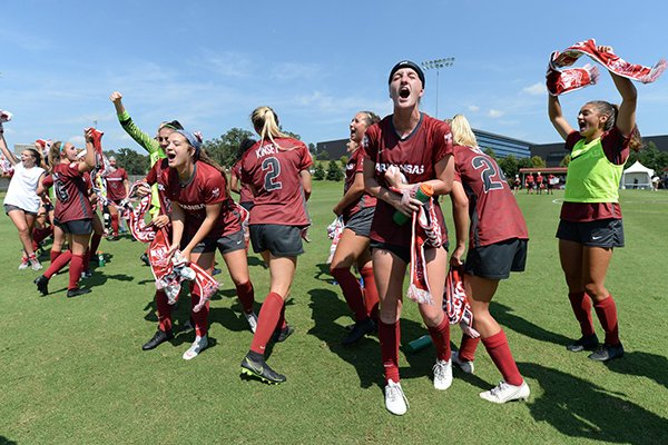 Arkansas players celebrate following a 2-0 victory over No. 1 North Carolina on Sunday, Sept. 15, 2019, in Fayetteville.