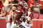 Arkansas Razorbacks defensive back LaDarrius Bishop (24) carries the ball for a pick-six after a fumble recovery during the fourth quarter of a football game, Saturday, September 14, 2019 at Donald W. Reynolds Razorback Stadium in Fayetteville.