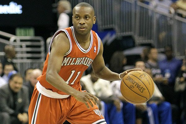Milwaukee Bucks' Earl Boykins moves the ball during the first half of an NBA basketball game against the Orlando Magic in Orlando, Fla., Tuesday, April 5, 2011.(AP Photo/John Raoux)