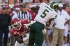 De'Jon Harris, Arkansas linebacker, tackles Marvin Kinsey, Colorado State running back, in the third quarter Saturday, Sept. 14, 2019, at Reynolds Razorback Stadium in Fayetteville.