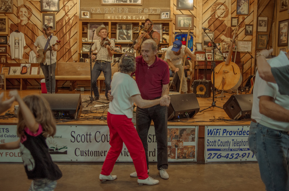 A couple dances to the music of the Hogslop String Band at the Carter Family Fold in Hiltons, Va. (The New York Times/MIKE BELLEME)