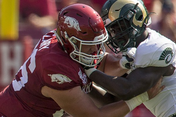 Arkansas center Ty Clary blocks a Colorado State defender during a game Saturday, Sept. 14, 2019, in Fayetteville.