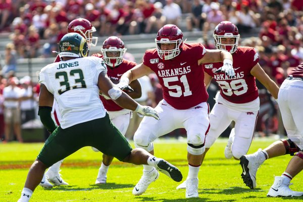 Ricky Stromberg of Arkansas opens up a whole against Manny ones of Colorado State during a football game, Saturday, September 14, 2019 at Donald W. Reynolds Stadium in Fayetteville, AR.