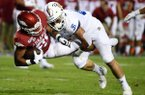 Arkansas running back Devwah Whaley, left, is tackled by San Jose State defender Kyle Harmon during the first half of an NCAA college football game, Saturday, Sept. 21, 2019, in Fayetteville. (AP Photo/Michael Woods)