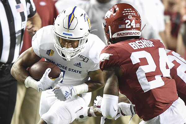 Arkansas defensive back LaDarrius Bishop pursues San Jose State receiver Isaiah Holiness during a game Saturday, Sept. 21, 2019, in Fayetteville.