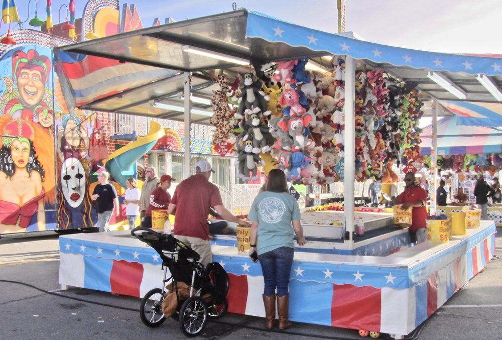 A midway with concessions and rides is a family feature of Stuttgart's Wings Over the Prairie Festival, set for Thanksgiving week. (Photo by Marcia Schnedler, special to the Democrat-Gazette)