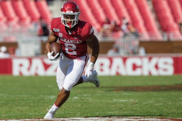 Chase Hayden, Arkansas running back, carries in the second quarter vs Colorado State Saturday, Sept. 14, 2019, at Reynolds Razorback Stadium in Fayetteville.