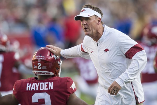 Chad Morris, Arkansas head coach, greets players during warmups before the game vs San Jose State Saturday, Sept. 21, 2019, at Reynolds Razorback Stadium in Fayetteville.