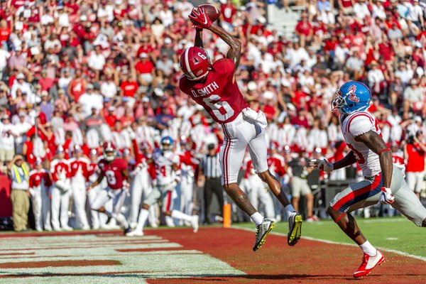 Alabama wide receiver DeVonta Smith (6) leaps into the air for his fourth touchdown reception well ahead of coverage from Mississippi defensive back Keidron Smith (20) during the first half of an NCAA college football game, Saturday, Sept. 28, 2019, in Tuscaloosa, Ala.