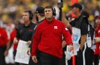 Rutgers head coach Chris Ash watches in the first half of an NCAA college football game against Michigan in Ann Arbor, Mich., Saturday, Sept. 28, 2019. (AP Photo/Paul Sancya)