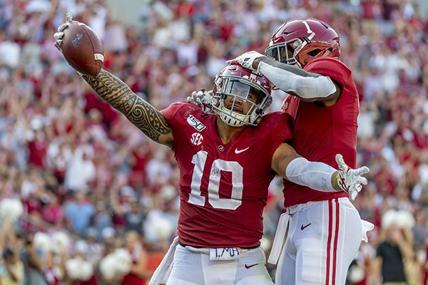 Alabama linebacker Ale Kaho (10) celebrates his special teams touchdown with Alabama linebacker Ben Davis (1) during the second half of an NCAA college football game against Mississippi, Saturday, Sept. 28, 2019, in Tuscaloosa, Ala. (AP Photo/Vasha Hunt)