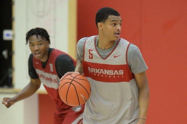 Arkansas guard Jalen Harris (5) looks to drive around guard Jimmy Whitt Jr. Thursday, Sept. 26, 2019, during practice in the Eddie Sutton Gymnasium inside the Basketball Performance Center in Fayetteville. Visit nwadg.com/photos to see more photographs from the practice.