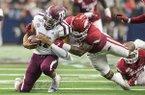 Arkansas linebacker De'Jon Harris tackles Texas A&M quarterback Kellen Mond during a game Saturday, Sept. 28, 2019, in Arlington, Texas.