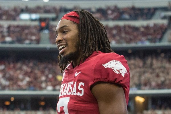 Trey Knox (right) laughs with Karch Gardiner, both Arkansas wide receivers, on the bench in the fourth quarter vs Texas A&M Saturday, Sept. 28, 2019, at AT&T Stadium in Arlington, Texas.