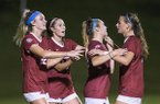 Arkansas players (from left to right) Parker Goins, Taylor Malham, Anna Podojil and Tori Cannata celebrate a goal during a game against Vanderbilt on Thursday, Sept. 26, 2019, in Fayetteville.