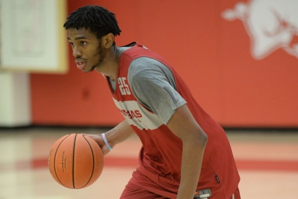 Arkansas guard Jimmy Whitt Jr. drives with the ball Thursday, Sept. 26, 2019, during practice in the Eddie Sutton Gymnasium inside the Basketball Performance Center in Fayetteville. Visit nwadg.com/photos to see more photographs from the practice.