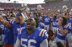 Florida players including defensive lineman Tedarrell Slaton (56) celebrate after defeating Auburn in an NCAA college football game, Saturday, Oct. 5, 2019, in Gainesville, Fla. (AP Photo/John Raoux)