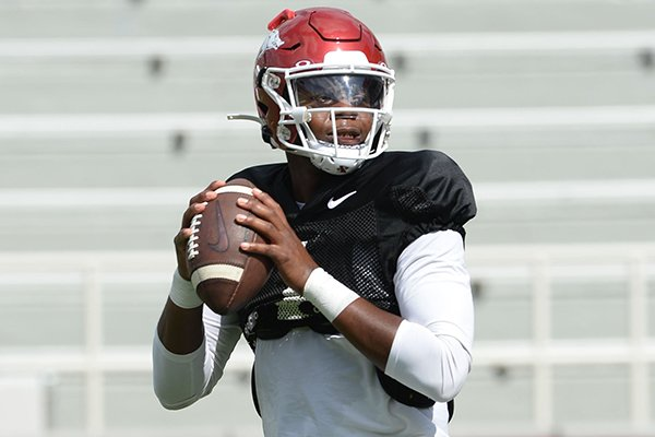 Arkansas quarterback K.J. Jefferson looks to pass Saturday, Aug. 24, 2019, during practice in Razorback Stadium in Fayetteville.