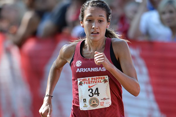 Arkansas' Taylor Werner comes in to the finish line Saturday, Oct. 5, 2019, to win the collegiate women's race during the Chile Pepper Cross Country Festival at Agri Park in Fayetteville.