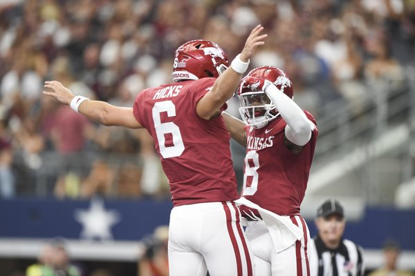 Arkansas Razorbacks wide receiver Mike Woods (8) reacts after a score during the second quarter of a football game, Saturday, September 28, 2019 at AT&T Stadium in Arlington, TX.