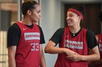 Guards Chelsea Dungee (LEFT) and Amber Ramirez wait their turn to talk to the media Wednesday Oct. 9, 2019 at the Arkansas Basketball Performance Center.