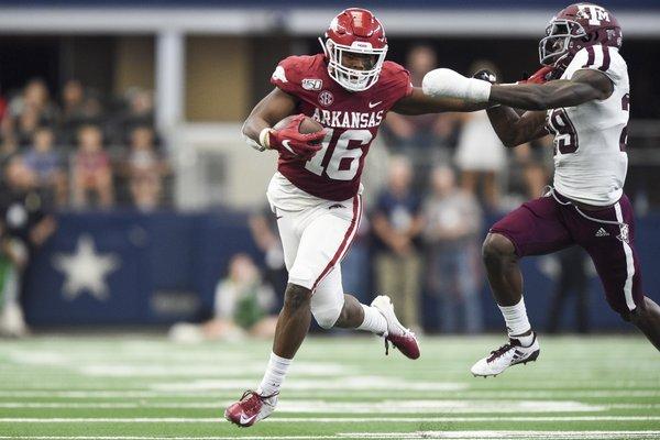 Arkansas Razorbacks wide receiver Treylon Burks (16) carries the ball during the fourth quarter of a football game, Saturday, September 28, 2019 at AT&T Stadium in Arlington, TX.