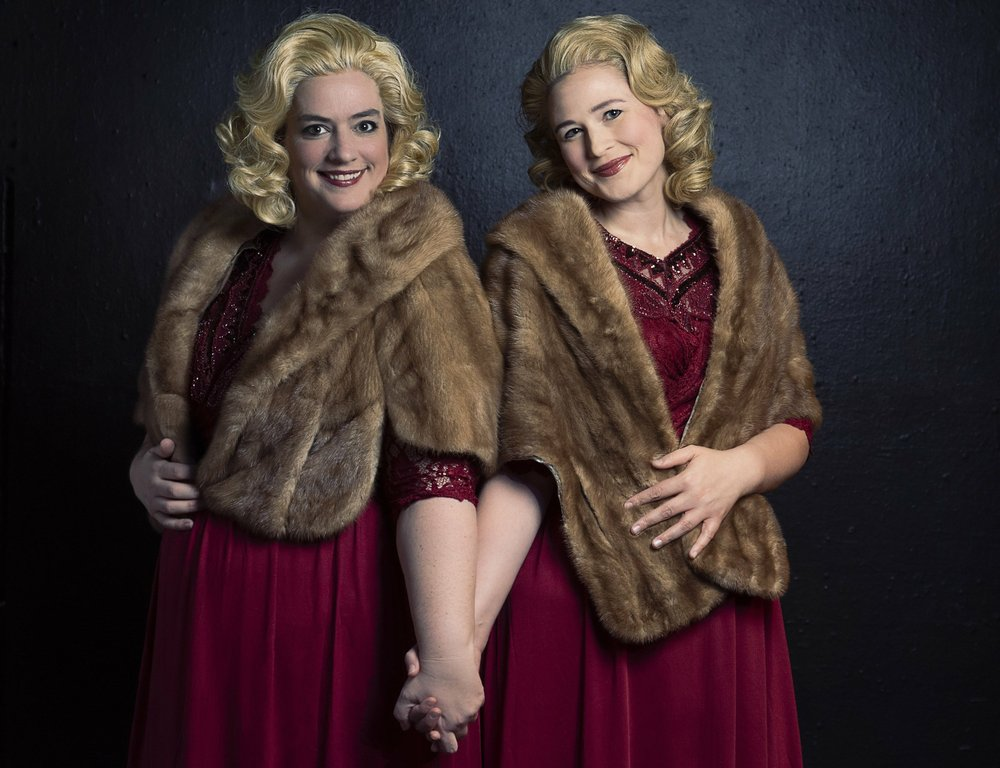 Erin Martinez Warner (left) and Sarah Haman play conjoined twins Daisy and Violet Hilton in ìSide Show,î opening Oct. 11 at The Weekend Theater.