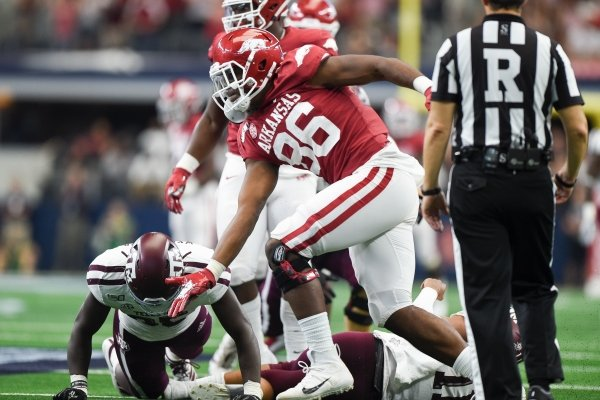 Arkansas Razorbacks defensive lineman Jamario Bell (86) reacts after sacking Texas A&M quarterback Kellen Mond (11) during the third quarter of a football game, Saturday, September 28, 2019 at AT&T Stadium in Arlington, TX.
